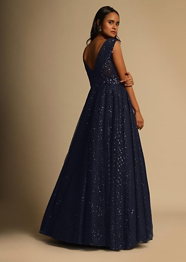 Midnight Blue Gown In Sequins Embellished Net With Ruching In The Front And Sheer Sides Online - Kalki Fashion