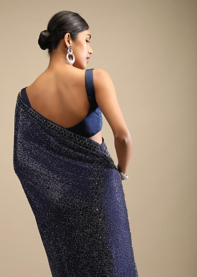 Midnight Blue Saree In Satin With A Heavy Embellished Pallu Using Scattered Sequins And Unstitched Blouse Online - Kalki Fashion