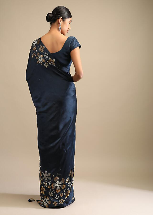 Midnight Blue Saree In Satin With Three Toned Kundan Embellished Floral Motifs Along The Border Online - Kalki Fashion