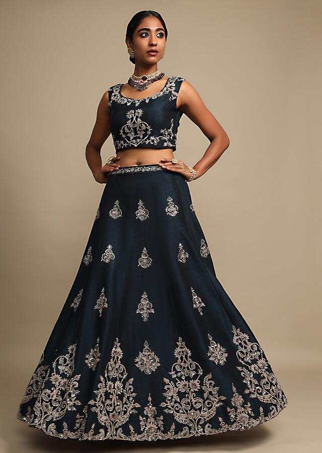 Midnight Teal Lehenga In Raw Silk With Zardozi Embroidered Floral Design On The Hem And Buttis Online - Kalki Fashion