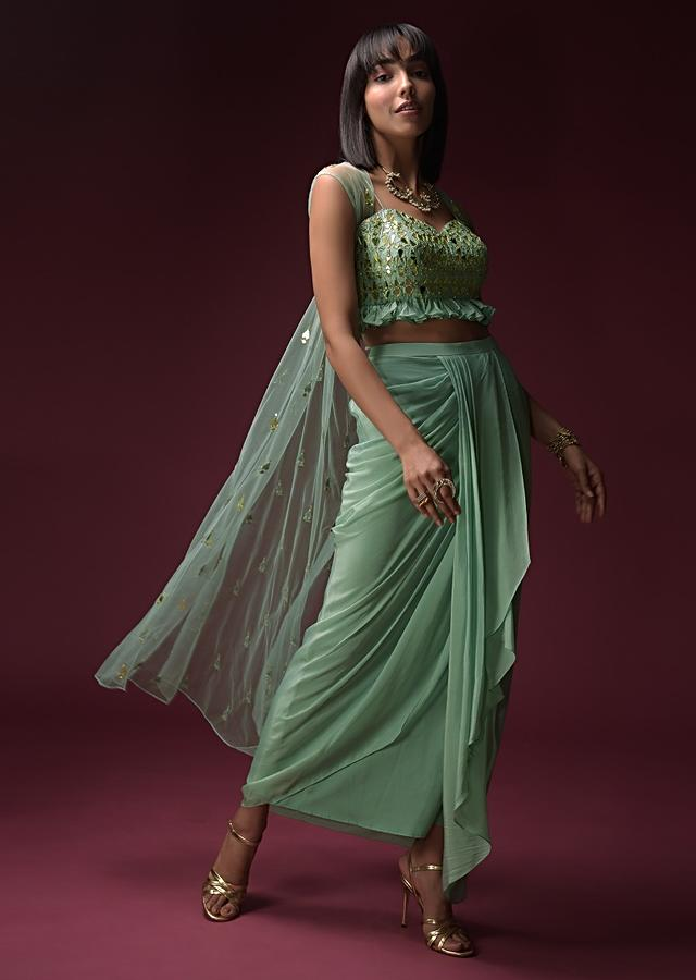 Mint Blue Dhoti Skirt And Ruffled Crop Top Set With Flower Shaped Mirror Work And Sleeveless Net Jacket Online - Kalki Fashion