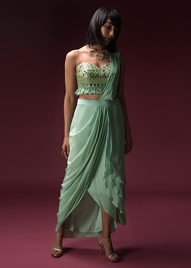 Mint Blue Dhoti Skirt With Attached Saree Drape And Ruffled Crop Top Adorned With Flower Shaped Mirror Work Online - Kalki Fashion