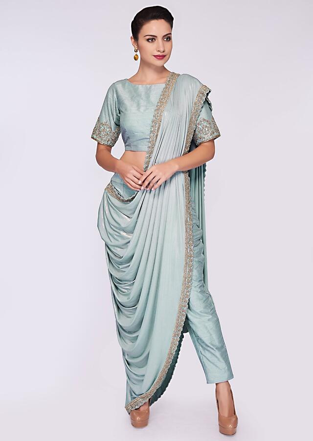 Mint blue saree with pant enhanced with a lycra top layer only on Kalki