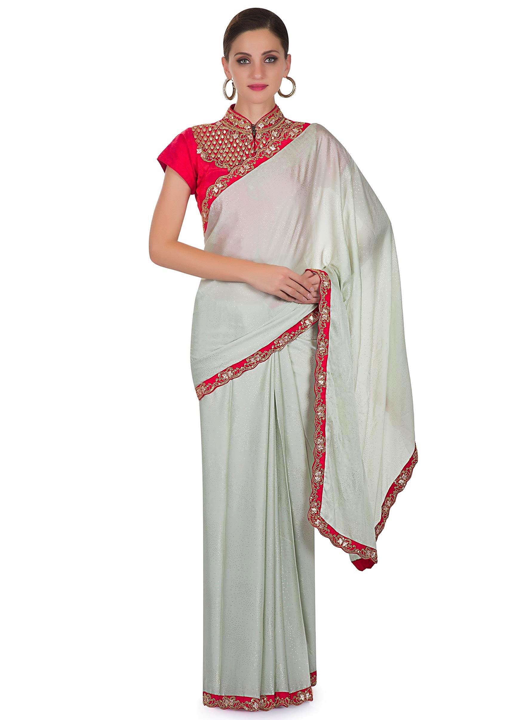 ced5676517d550 Mint Blue Satin Georgette Saree with Stitched Orange Raw Silk Blouse  Featuring Zari Work only on KalkiMore Detail