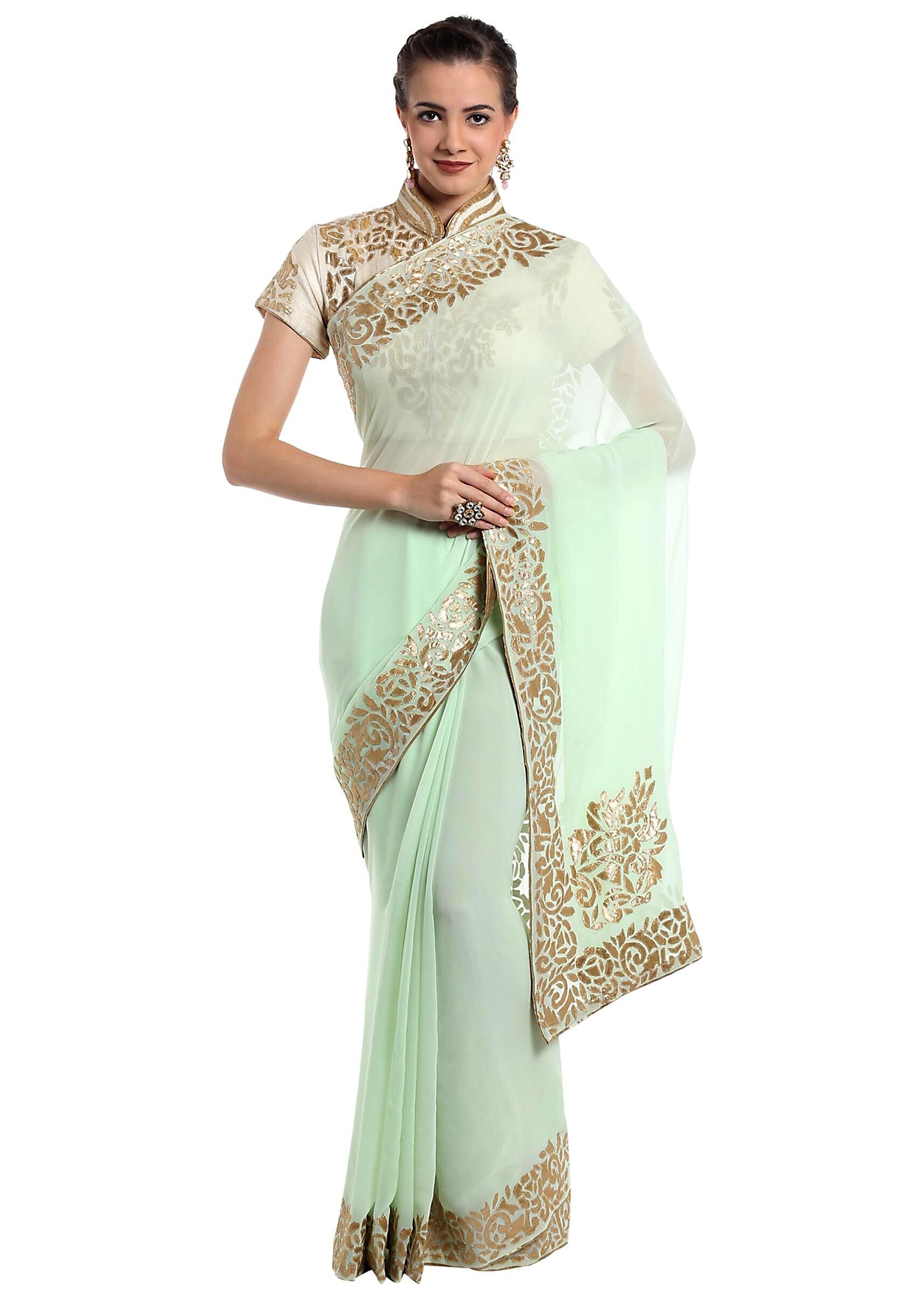 0ca658b5f7 Mint green georgette saree adorned with applique work only on Kalki