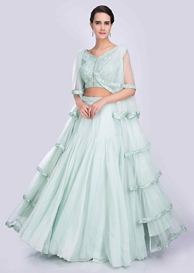Mint Green Lehenga Paired A With Heavy Embellished Blouse With Long Flared Sleeves With Frilled Layers Online - Kalki Fashion