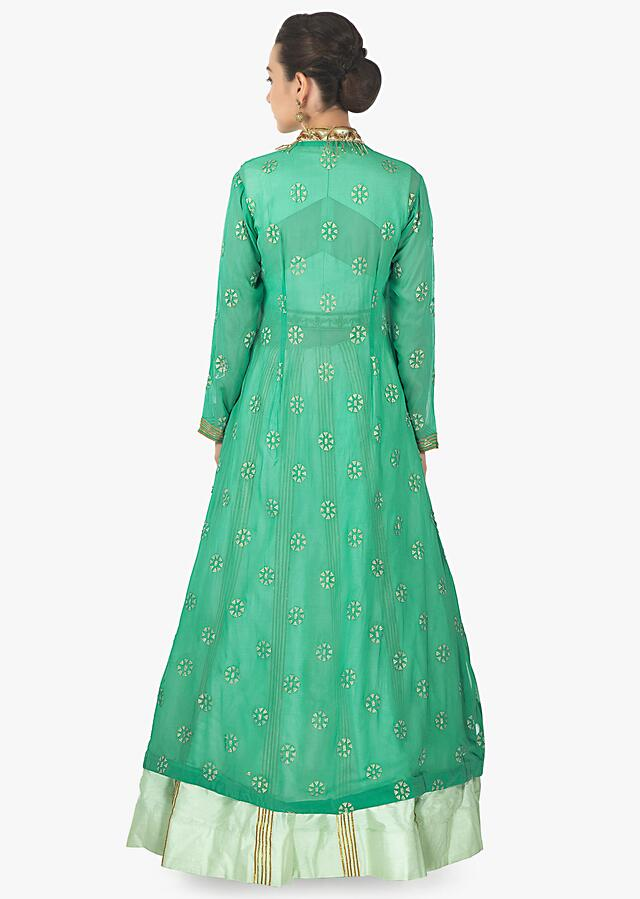 Mint green lehenga with embroidered blouse matched with long jacket in tassel only on Kalki