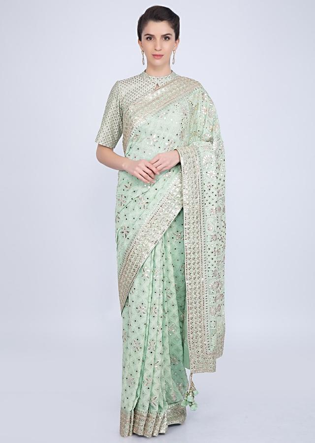Mint green saree in lucknowi embroidered georgette  Online - Kalki Fashion
