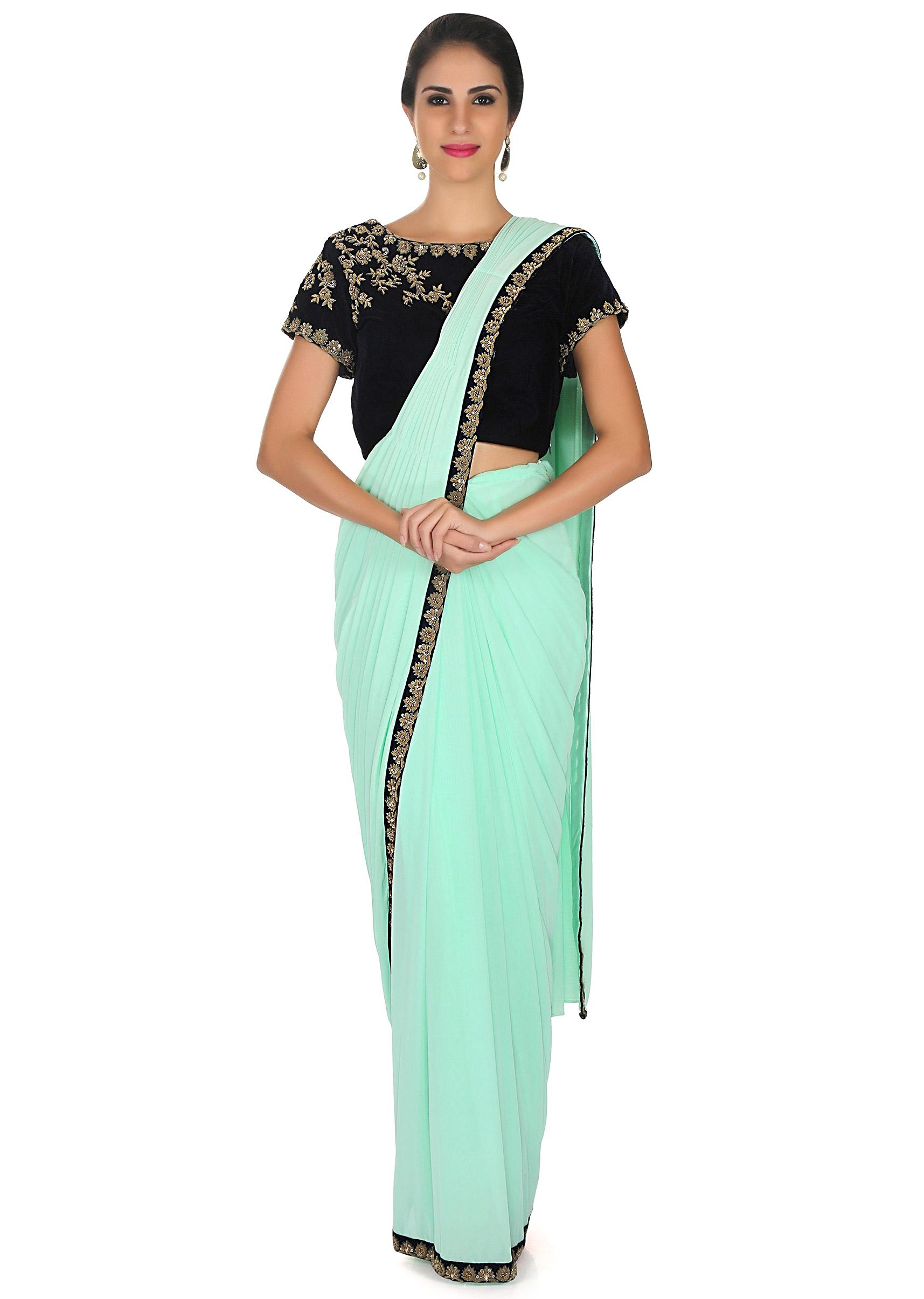 68f962c9c713c5 Mint green pre stitched saree with navy blue ready embroidered blouse only  on KalkiMore Detail
