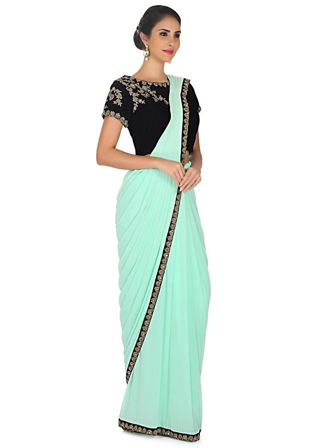 Mint green pre stitched saree with navy blue ready embroidered blouse only on Kalki