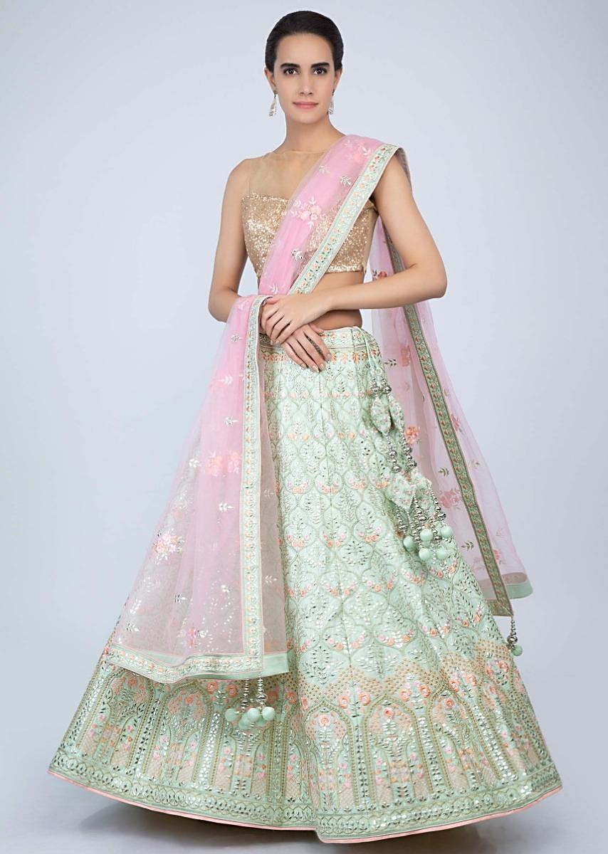 5b0af230f9 Mint green raw silk heavy embroidered lehenga with contrasting baby pink  net dupatta only on Kalki