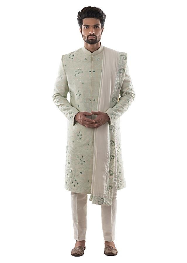 Mint Green Sherwani With Self Thread Work Paired With Cream Silk Dupatta And Cream Pant Pajama. Online - Kalki Fashion