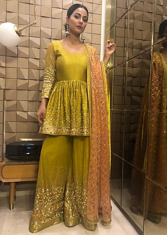 Hina Khan in Kalki mirror embroidered suit and sharara with contrasting peach net dupatta