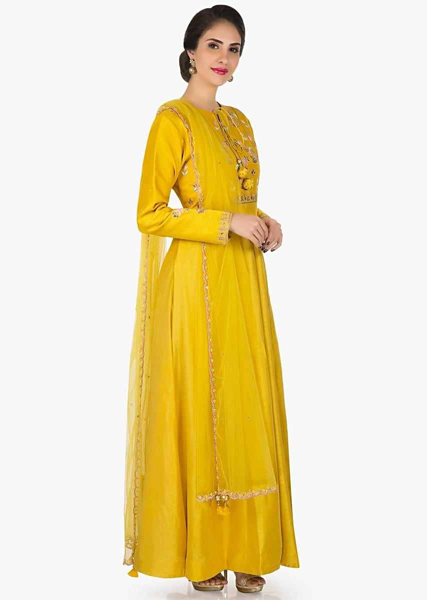 92db19f0c485a Yellow silk anarkali suit embellished in resham and gota patch work only on  KalkiMore Detail