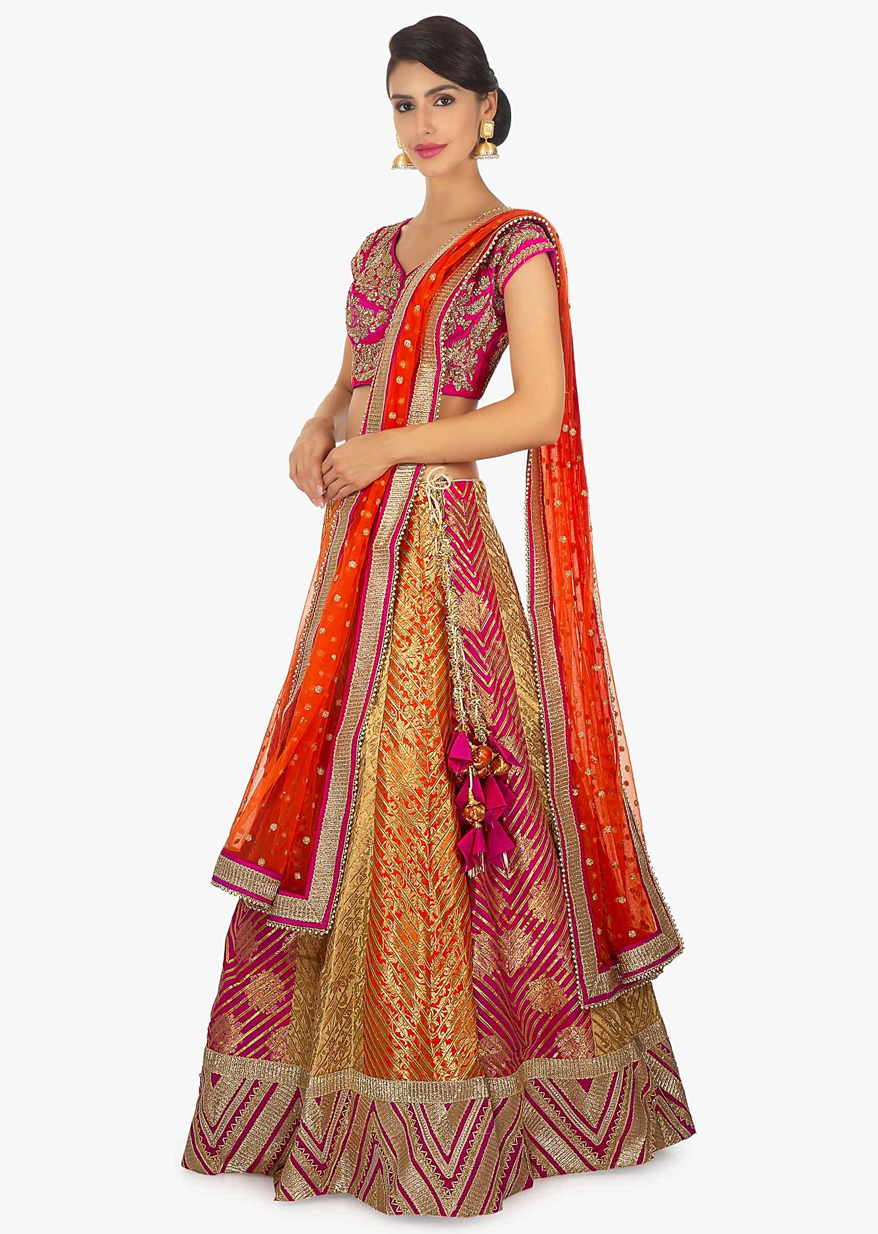 c595a11940cd8a Multi color brocade lehange paired with a fusia pink silk blouse and rust  net dupatta only ...