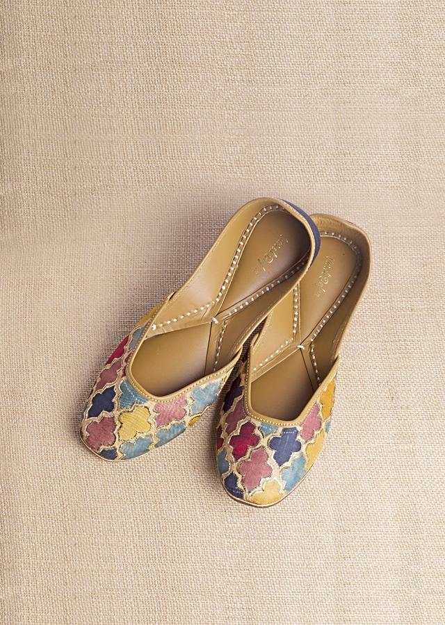 Multi Color Juttis In Raw Silk With Multi Colored Mughal Jaal And Pita Zari Highlights  By Vareli Bafna
