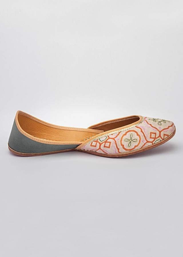 Multi Colored Juttis In Customized Moroccan Printed Linen With Silver Zari Thread Detailing By Vareli Bafna