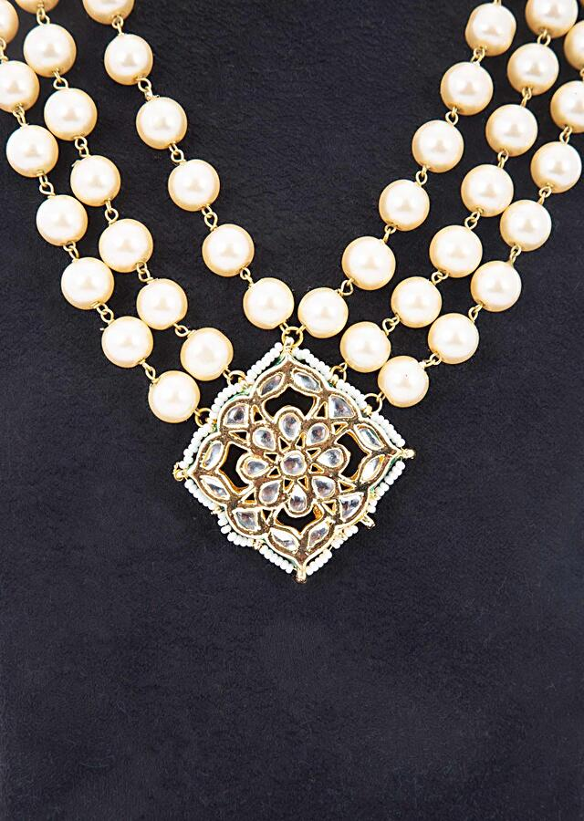Multi layer cream pearls necklace with kundan studded pendant only on kalki