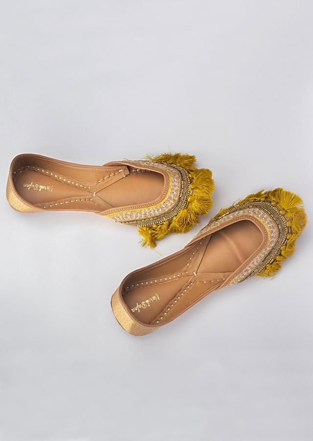 Mustard Juttis In Khadi Silk With Beads And Sequins Work Along With Tassels By Vareli Bafna