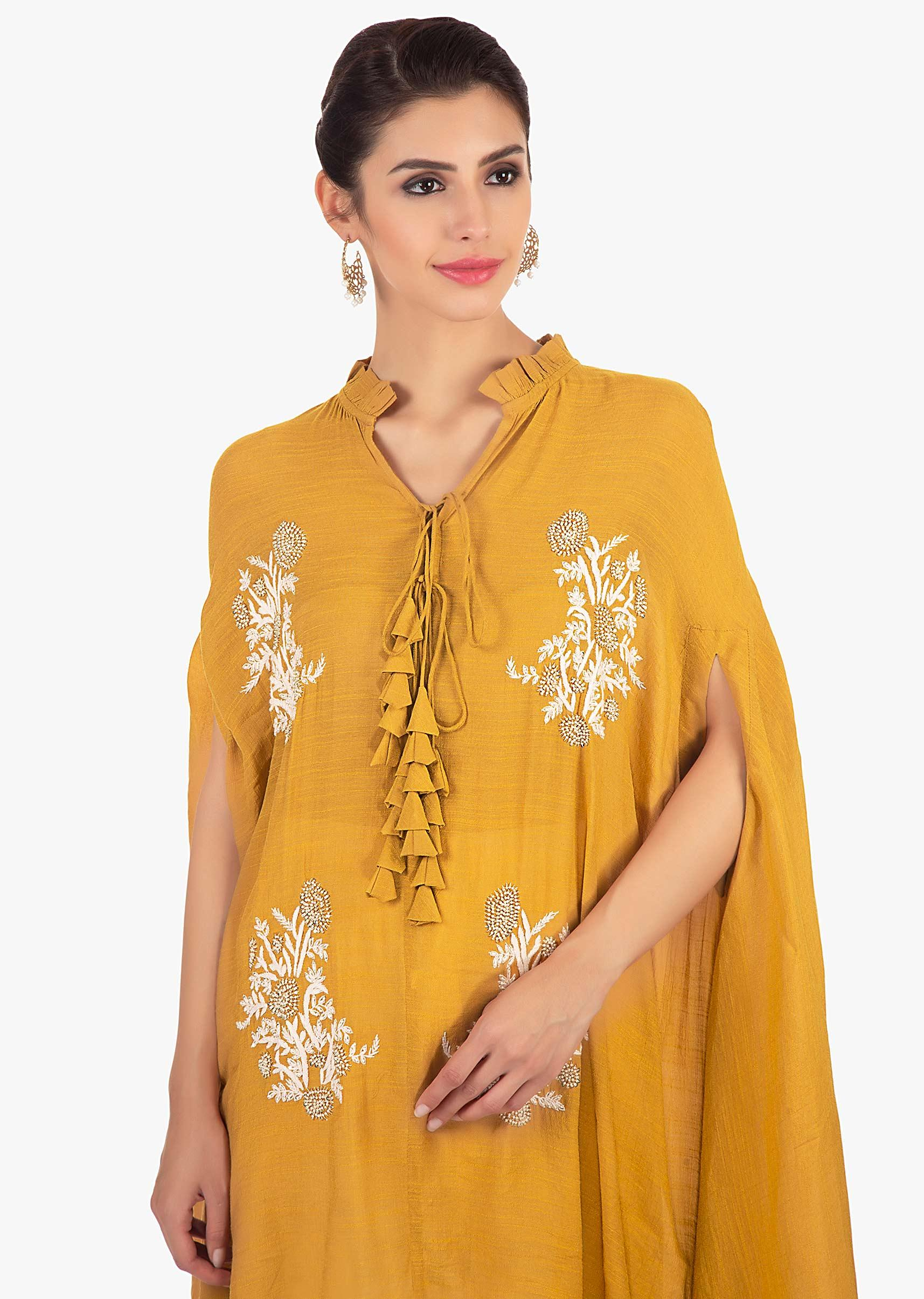 77ab7c51bb006 Mustard kaftan top paired with a cream cotton dhoti salwar only on Kalki