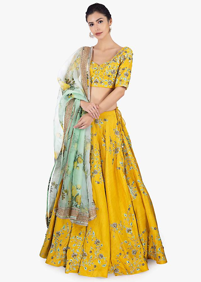 Mustard Lehenga Set In Raw Silk Paired With A Green Organza Dupatta Online - Kalki Fashion