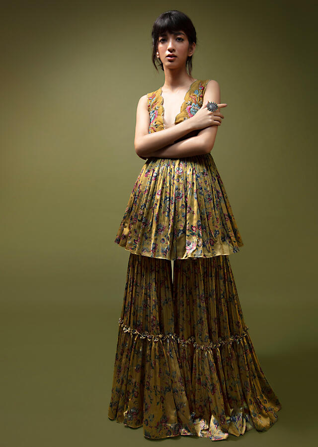 Mustard Sharara Suit In Floral Printed Satin And Raw Silk Bodice Featuring A Plunging Neckline And Hand Embroidered Floral Motifs Online - Kalki Fashion