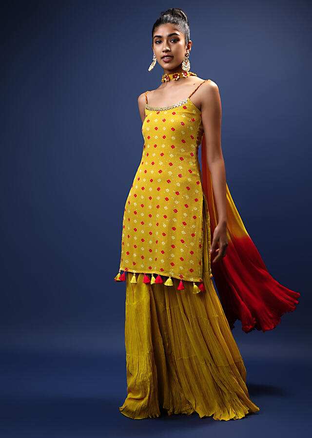 Mustard Sharara Suit In Georgette With Bandhani Printed Buttis And Tassels On The Border Online - Kalki Fashion