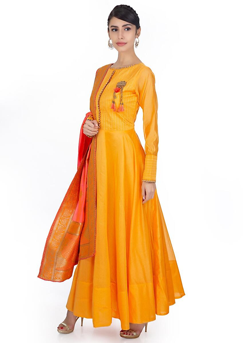 7857933c854a9 Mustard silk anarkali dress paired with coral silk weaved dupatta with brocade  border only on Kalki