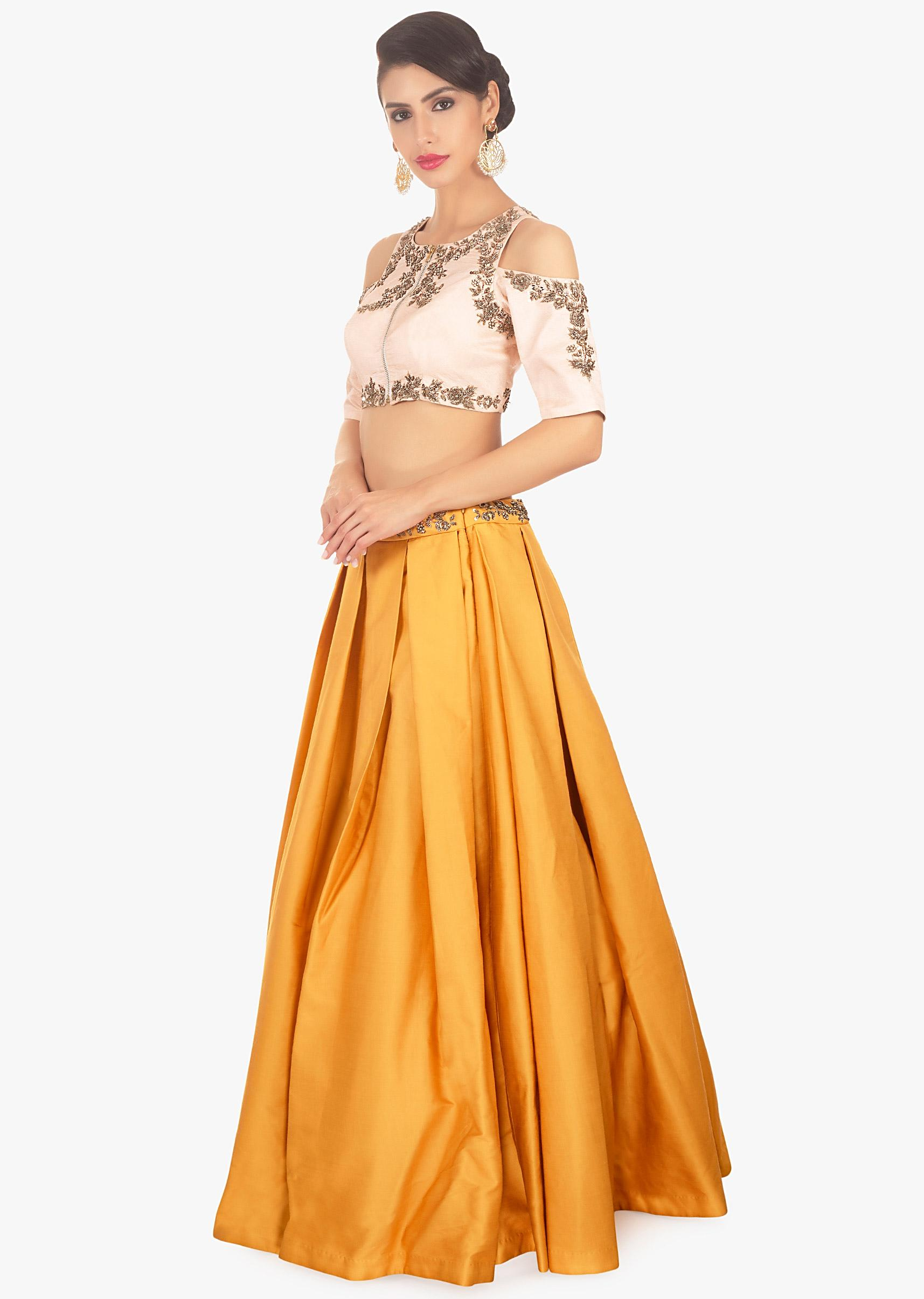 edc387625d17a Mustard skirt paired with light peach cold shoulder crop top only on Kalki