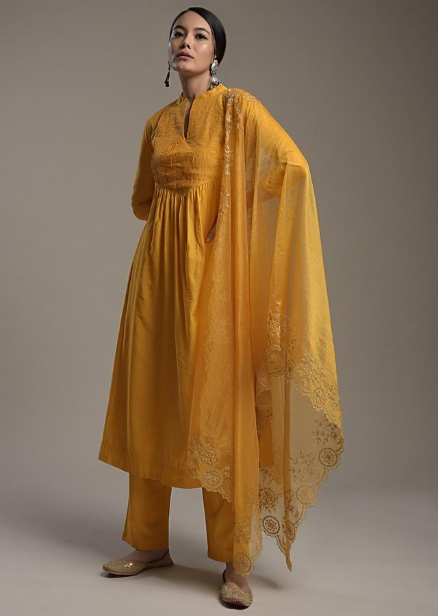 Mustard Yellow A Line Suit In Cotton With Pin Tucks Detailing And Teamed With A Zari Embroidered Organza Dupatta Online - Kalki Fashion