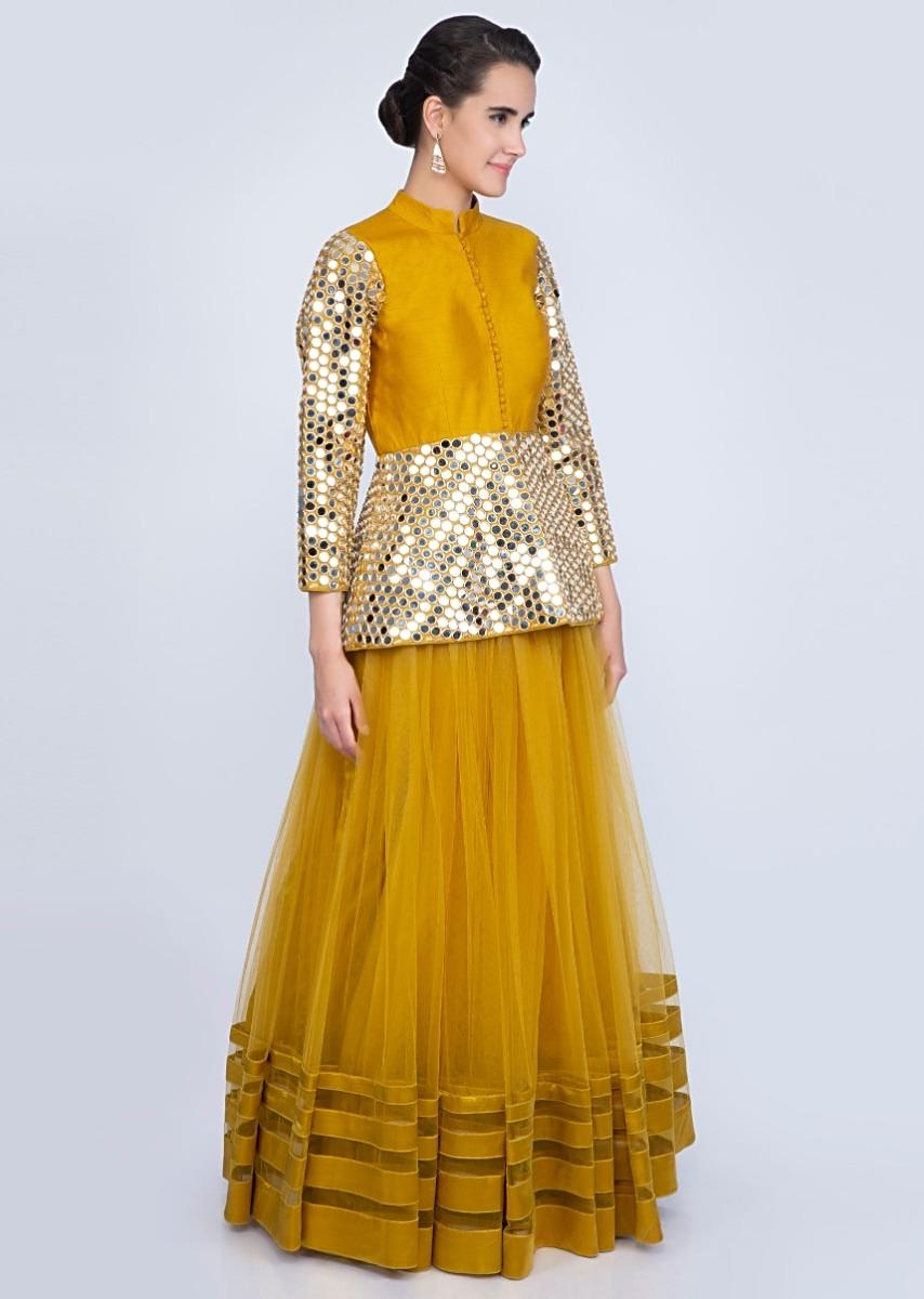 78e85d793c01c Mustard yellow net lehenga with mirror embroidered peplum blouse only on  Kalki