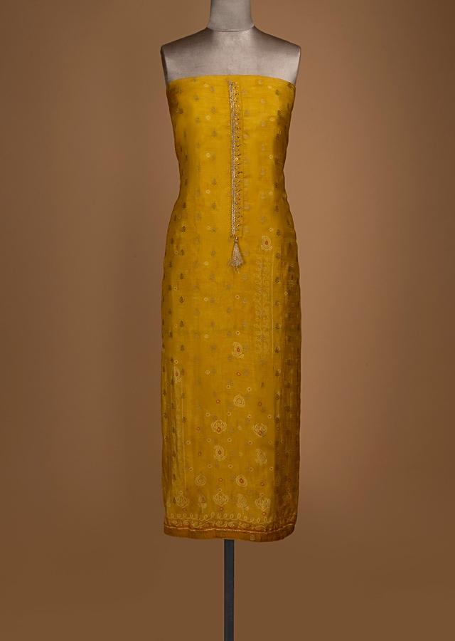 Mustard Yellow Unstitched Suit With Bandhani Print And Weaved Buttis Online - Kalki Fashion