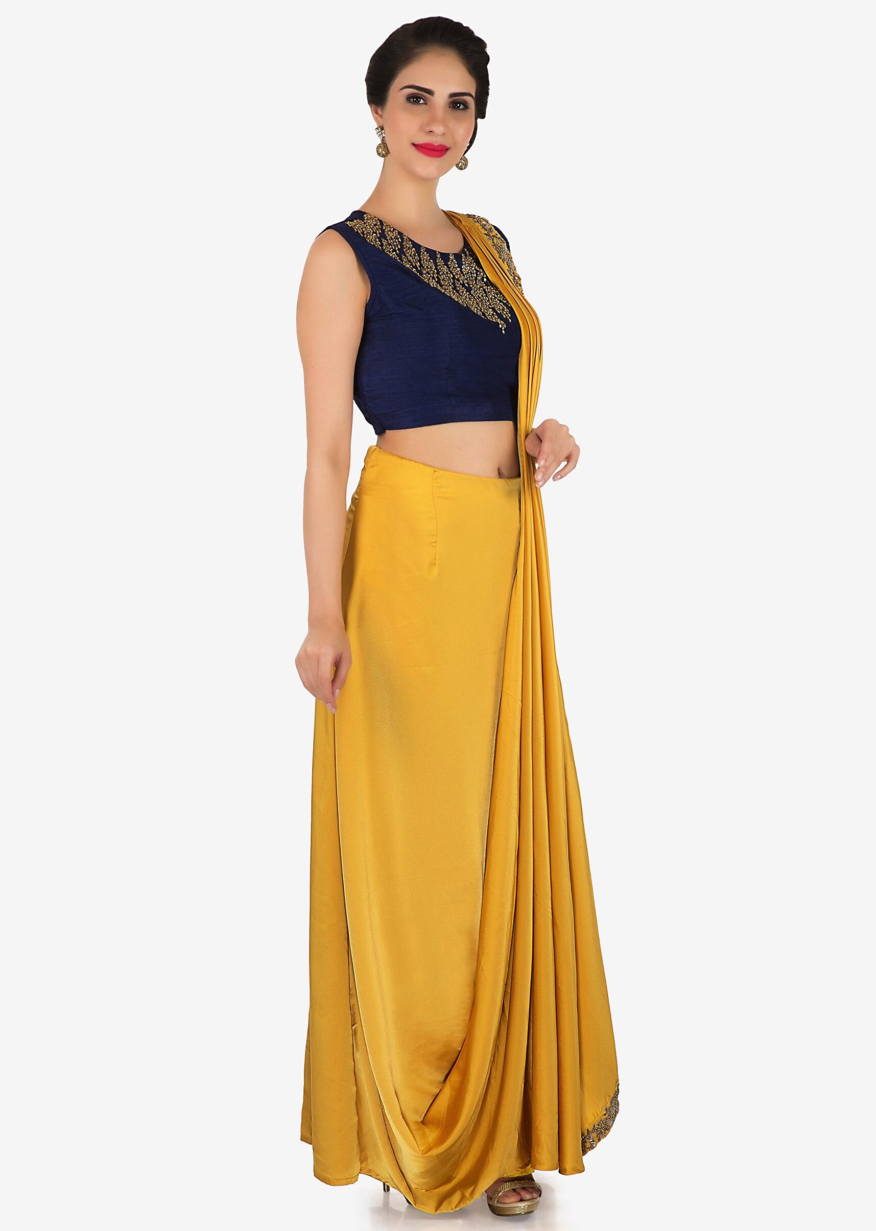 169548ccb220a Mustard pre stitched saree with navy blue raw silk blouse only on Kalki