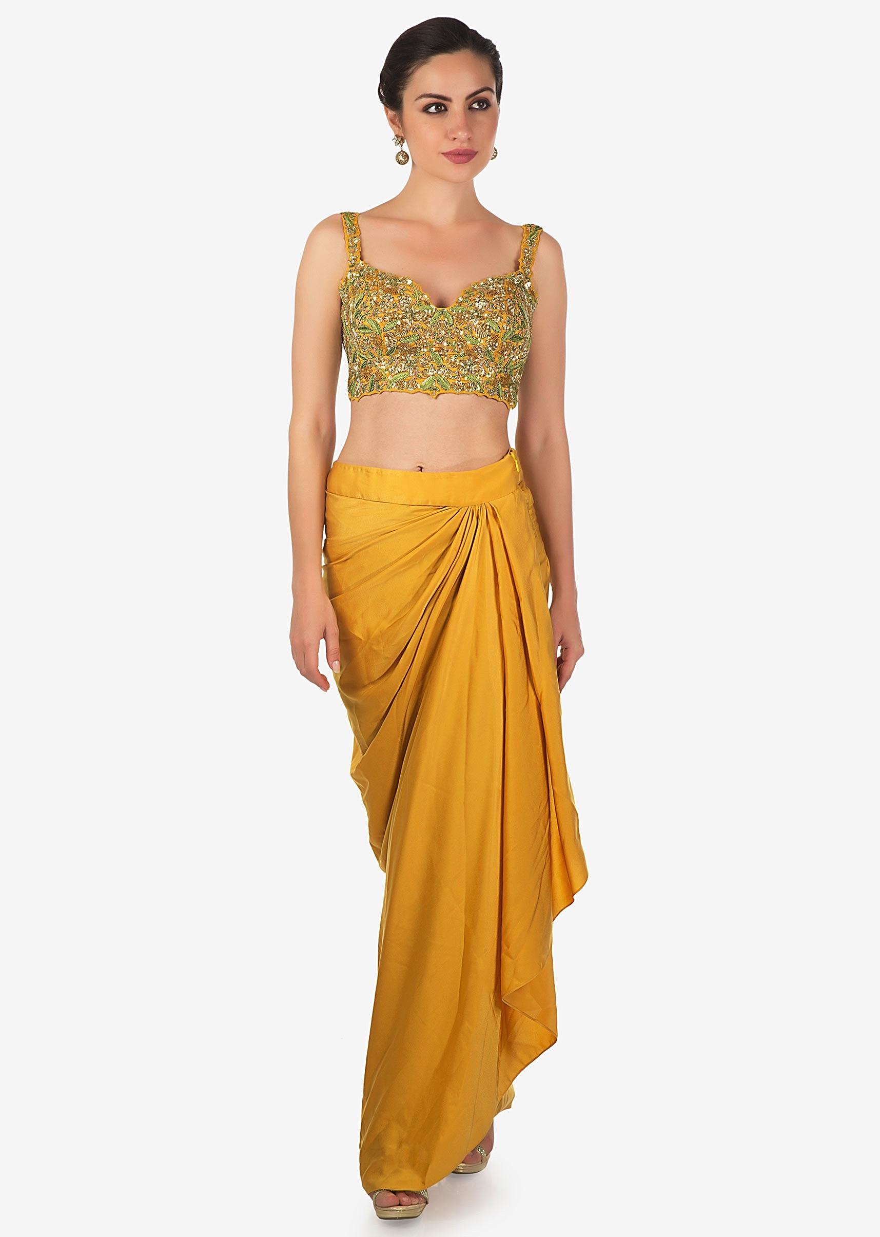 b753331177c5 Mustard skirt in cowl drape matched with embroidered blouse and fancy jacket  only on Kalki