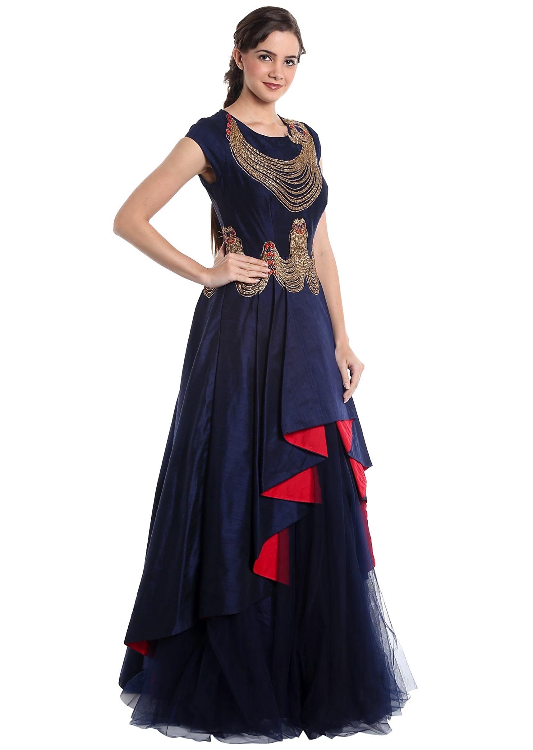 9efd2e31aa Navy blue raw silk and net gown with zari work and cascading hemline only  on Kalki
