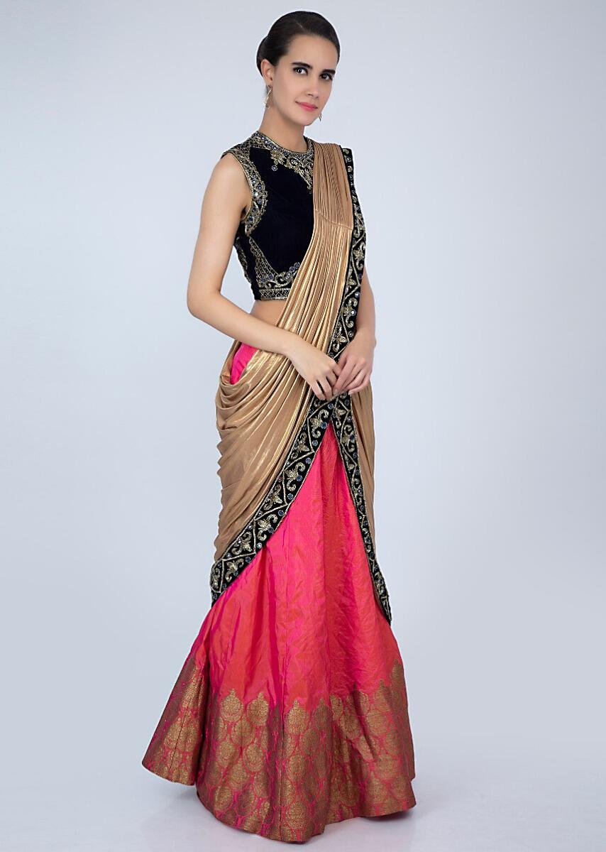 7ca9cd4fbc Navy blue velvet blouse matched with coral pink lehenga with attached  draped dupatta only on Kalki