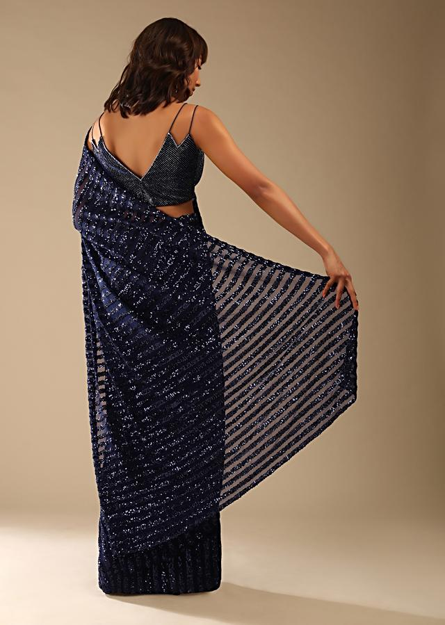 Navy Blue Saree In Striped Sequins Fabric And A Cut Dana Embellished Velvet Blouse With Double Spaghetti Straps Online - Kalki Fashion