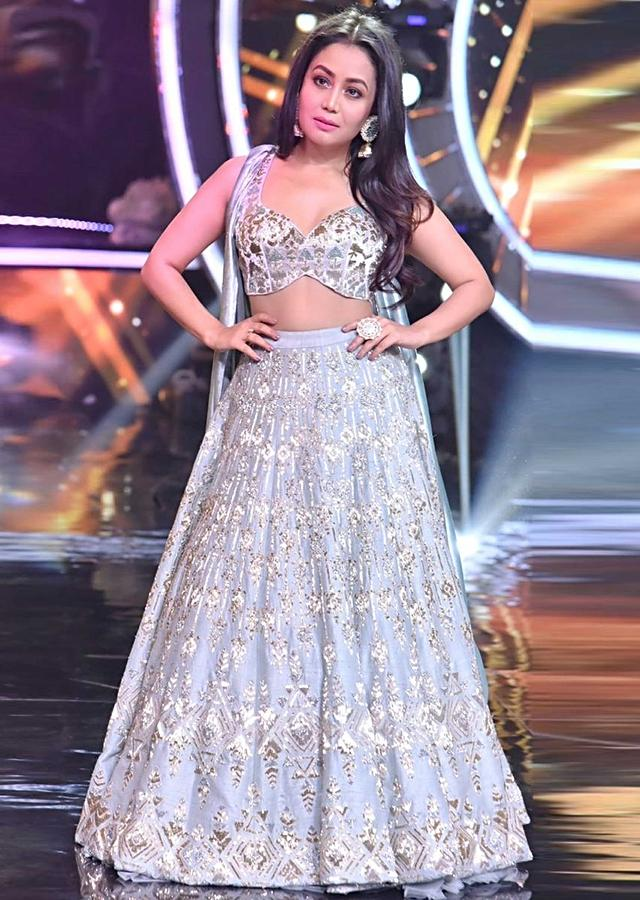 Neha Kakkar in Kalki raw silk lehenga set with greek inspired velvet trail attached to the blouse