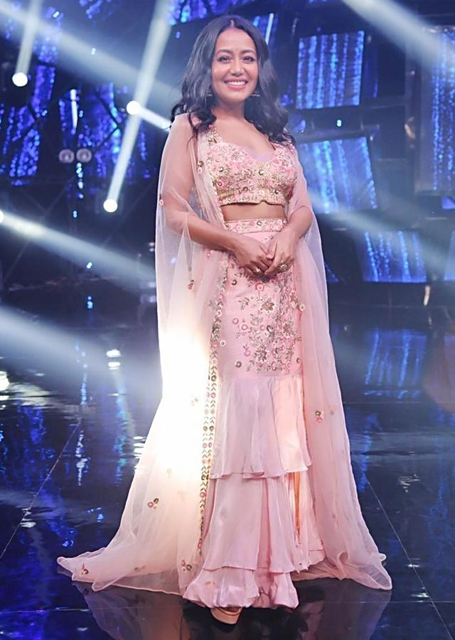 Neha Kakkar In Kalki Salmon Pink Skirt With Ruffle Layers In Raw Silk And Crepe With Crop Top And Net Jacket