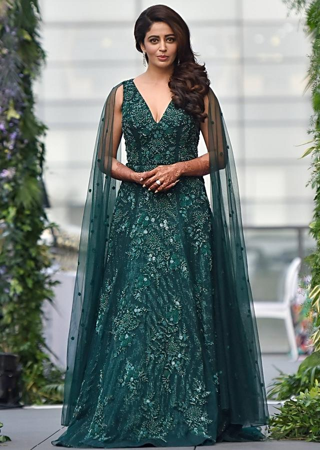 Neha Pendse In Kalki Bottle Green Gown With Attached Net Dupatta And Floral Embroidery