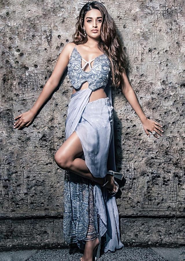 Nidhhi Agerwal in Kalki blue heather fancy saree gown with side slit drape and attached pallo only on Kalki
