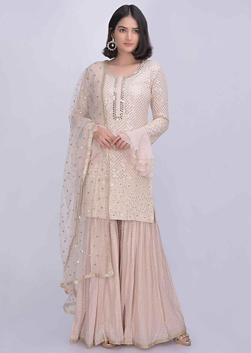 6537aac7f24 Nude beige chiffon sharara suit with matching net dupatta only on Kalki