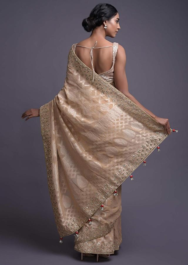 Oat Beige Saree In Georgette With Weaved Pattern And Gotta Work Online - Kalki Fashion