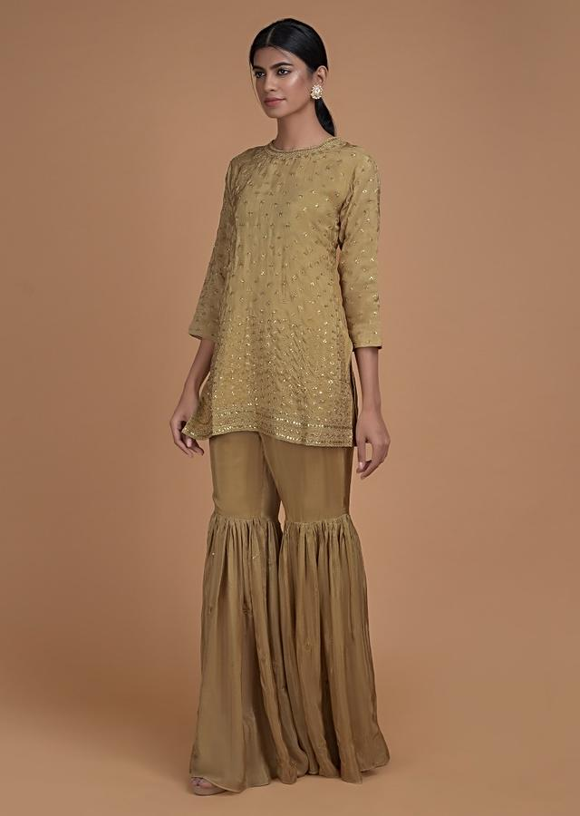 Oat Beige Sharara Suit In Satin Crepe With Short Kurti And Sequins Embroidered Buttis Online - Kalki Fashion