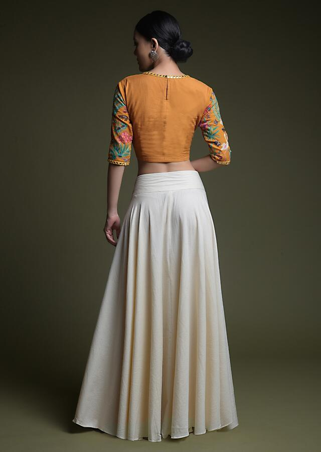Ochre Yellow Crop Top With Kashmiri Hand Embroidery And Contrasting Off White Skirt Online - Kalki Fashion