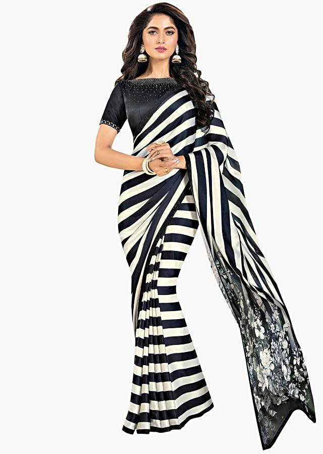Black and white strap saree with floral printed pallo only on Kalki