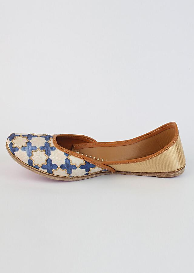 Off White And Royal Blue Juttis With Jaal Print And Zari Accents By Vareli Bafna