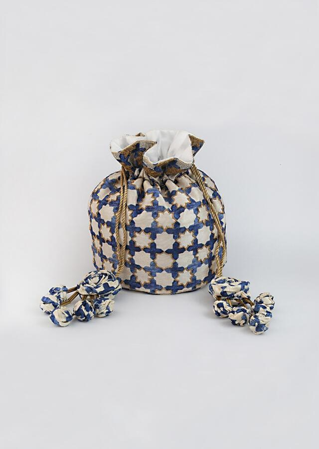 Off White And Royal Blue Potli Bag With Jaal Print And Gold Dori Work By Vareli Bafna