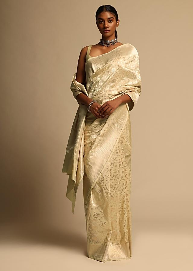 Off White Banarasi Saree In Pure Handloom Silk With Woven Floral Jaal And Floral And Checks Border Along With Unstitched Blouse Piece Online - Kalki Fashion