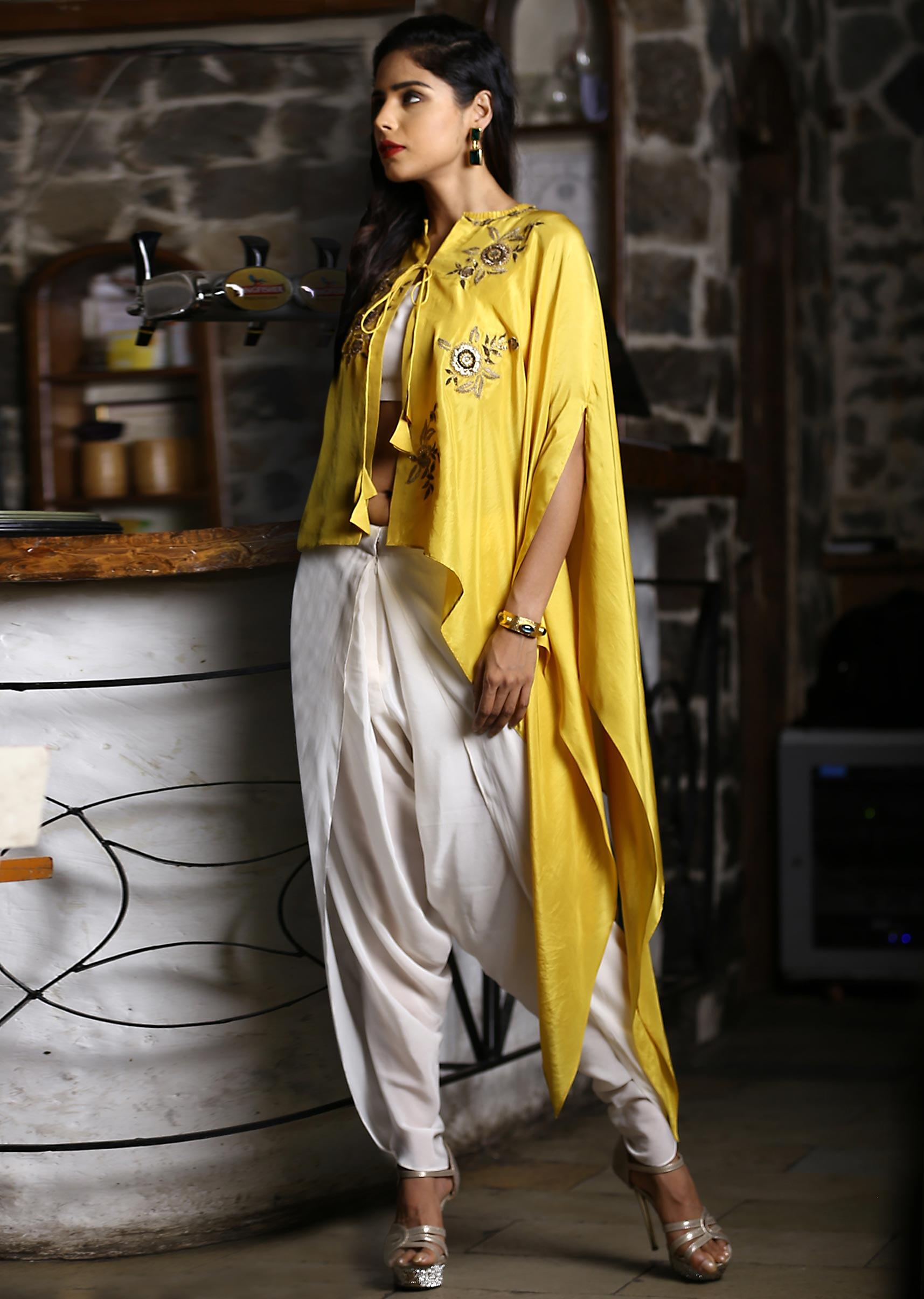 d07530cc75ac6 Off white dhoti pant and crop top paired with embroidered mustard kaftan  only on Kalki